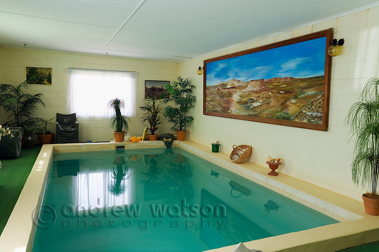 Indoor swimming pool in Faye's underground home.  The famous home was built by three pioneering women in the 1960s using pick and shovel.  Coober Pedy, South Australia, AUSTRALIA.