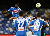 25th July 2020; Stadio San Paolo, Naples, Campania, Italy; Serie A Football, Napoli versus Sassuolo; Kalidou Koulibaly of Napoli rises highest to get his header on target but saved
