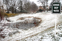 Hertfordshire - Snow scenes in Hertfordshire. Pictured - Pond frozen over and covered in snow, near Ickleford - January 18th 2012..Photo by Keith Mayhew