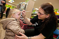 Rhiannon Bailey-Evans (2) with face painter Cheryl Whitfield