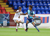 Sido Jombati of Wycombe Wanderers goes in for a tackle during the Friendly match between Aldershot Town and Wycombe Wanderers at the EBB Stadium, Aldershot, England on 26 July 2016. Photo by Alan  Stanford.