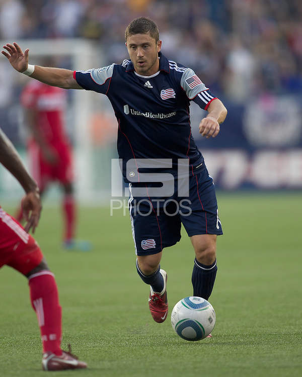 New England Revolution midfielder Chris Tierney (8) on the attack. In a Major League Soccer (MLS) match, the New England Revolution tied the Chicago Fire, 1-1, at Gillette Stadium on June 18, 2011.