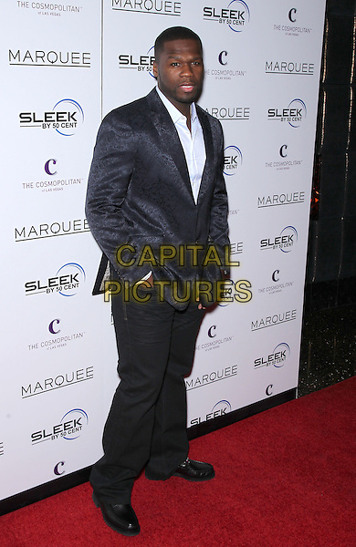 CURTIS JACKSON aka 50 Cent .50 Cent celebrates the release of Sleek by 50 Cent wireless headphones at Marquee Nightclub inside The Cosmopolitan of Las Vegas, Las Vegas, Nevada, USA, .7th January 2011..full length fifty fiddy black suit white shirt hands in pockets patterned .CAP/ADM/MJT.© MJT/AdMedia/Capital Pictures.