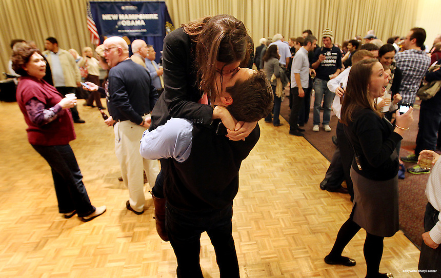 NH campaign organizer Kate Malloy and Manchester alderman Garth Corriveau kiss at the Obama victory party in Manchester, N.H., Tuesday, Nov. 6, 2012 . (Cheryl Senter for the New York Times)