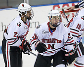 Greg Costa (NU - 22), Mike Hewkin (NU - 28) - The Northeastern University Huskies defeated the St. Thomas Tommies 7-5 in their exhibition match on Saturday, October 3, 2009, at Matthews Arena in Boston, Massachusetts.