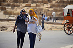 Egyptians celebrate on the third day of Eid al-Fitr holiday at Giza pyramids, which marks the end of the Muslim holy month of Ramadan, in Cairo June 27, 2017. Photo by Amr Sayed