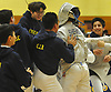 Jonathan Sheng of Jericho gets mobbed by teammates after winning the clinching bout in boys fencing Long Island Championship against Ward Melville at Jericho High School on Tuesday, Feb. 6, 2017.