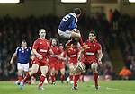Wales pair George North and Taulupe Faletau wait to pounce on French full back Brice Dulin as he leaps to take the high ball.<br /> RBS 6 Nations 2014<br /> Wales v France<br /> Millennium Stadium<br /> 21.02.14<br /> <br /> &copy;Steve Pope-SPORTINGWALES