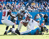 The Carolina Panthers defeated the Atlanta Falcons 34-10 in an inter-division rivalry played in Charlotte, NC at Bank of America Stadium.  Atlanta Falcons running back Jacquizz Rodgers (32) is tackled by Carolina Panthers outside linebacker Thomas Davis (58)