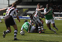 A tussle in the St Mirren v Hibernian Clydesdale Bank Scottish Premier League match played at St Mirren Park, Paisley on 29.4.12.