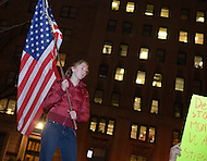 December 1, 2011  (Washington, DC)  A woman with OccupyDC holds the American flag as more than 100 people protested a Democratic fund raising dinner in Washington.  The dinner, with plates starting at $5,000, was sponsored by the Democratic Congressional Campaign Committee (DCCC), whose principle mission is to support Democratic House candidates.   (Photo by Don Baxter/Media Images International)