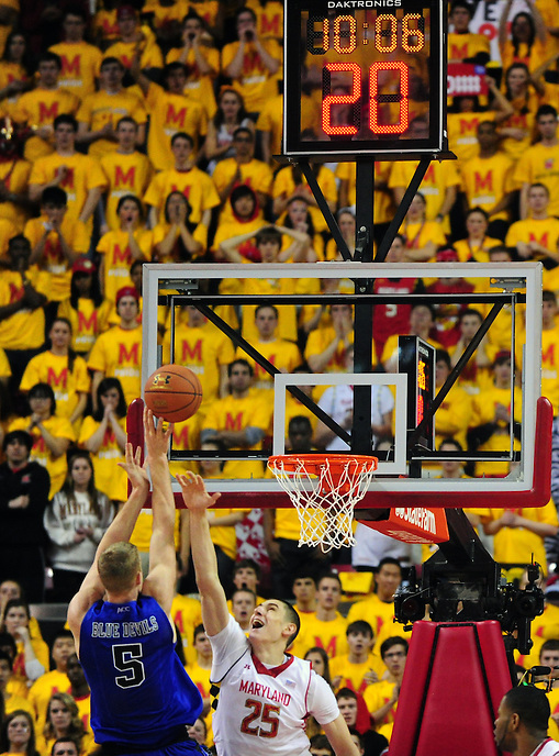 Mason Plumlee of the Blue Devils shoots over Alex Len of the Terrapins. Maryland defeated Duke 81-83 at the Comcast Center in College Park, MD on Saturday, February 16, 2013. Alan P. Santos/DC Sports Box