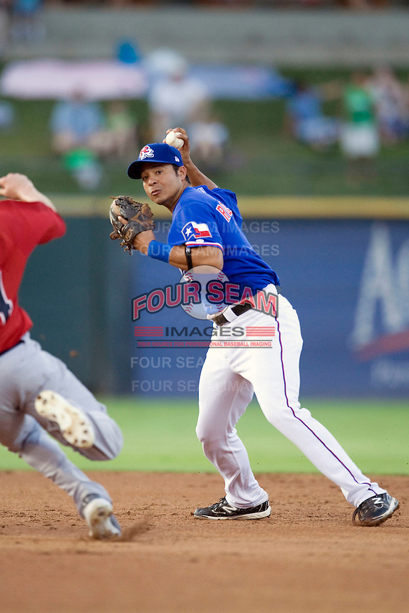 Round Rock Express shortstop Guilder Rodriguez #1 turns a double play against the Memphis RedBirds at the Dell Diamond on July 10, 2011in Round Rock, Texas.  Memphis defeated Round Rock 10-9.  (Andrew Woolley / Four Seam Images)