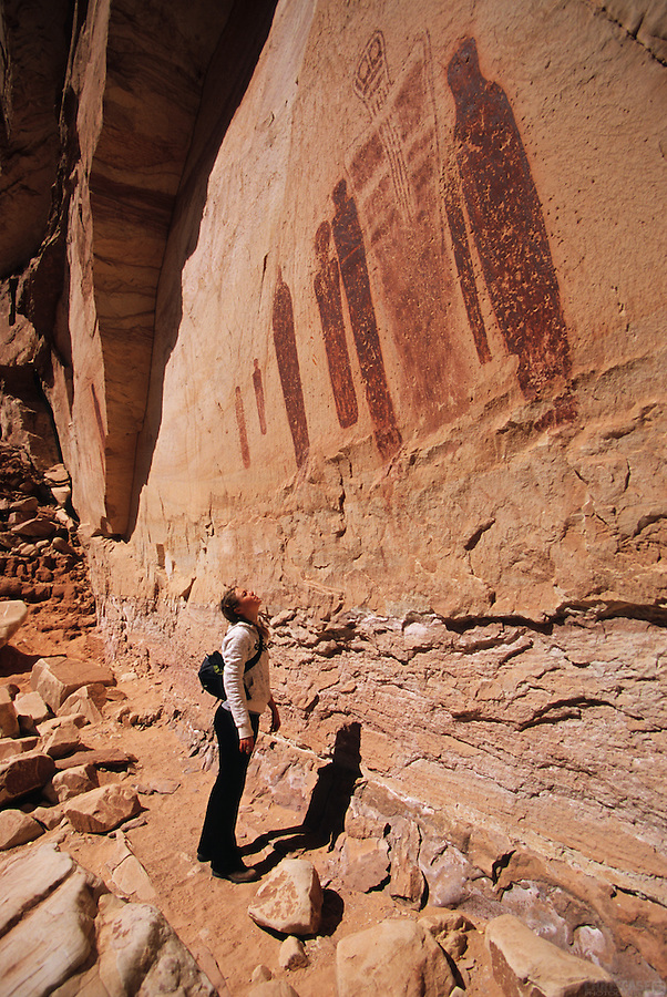 A visitor gazes up at the sights of the Great Gallery, Horseshoe Canyon, Canyonlands National Park, Utah.