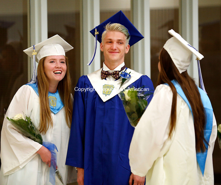 Washington, CT- 13 June 2015-061315CM02-  Shepaug Valley High School graduates,  Rachel Crossley, left, Sebastian Taylor (also the class' valedictorian, and Kelsey Johnson share a laugh before the start of commencement exercises at the high school on Saturday.   Christopher Massa Republican-American