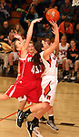 SIOUX FALLS, SD: DECEMBER 20: Hannah Nieman #24 from Washington lays the ball up against Whitlee Larson #4 from Yankton in the the second half of their game Friday night at Washington. (photo by Dave Eggen/Inertia)