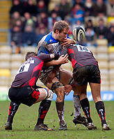 Andy Beattie has the ball dislodged from his grasp after a hard double-tackle from Ernst Joubert and Michael Tagicakibau. Guinness Premiership match between Saracens and Bath on February 28, 2010 at Vicarage Road in Watford, England. [Mandatory Credit: Patrick Khachfe/Onside Images]