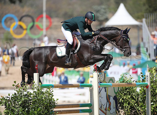 14.08.2016. Rio de Janeiro, Brazil. Alvaro Doda de Miranda of Brazil on horse Cornetto K clears an obstacle during the Jumping Team 1st Qualifier of the Equestrian competition at the Olympic Equestrian Centre during the Rio 2016 Olympic Games in Rio de Janeiro, Brazil, 14 August 2016.