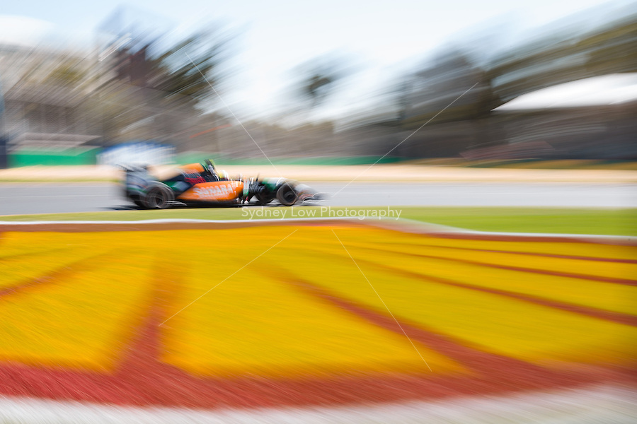 March 14, 2014: Sergio Perez (MEX) from the Sahara Force India F1 Team rounds turn three during practice session one at the 2014 Australian Formula One Grand Prix at Albert Park, Melbourne, Australia. Photo Sydney Low.