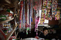 A young boy tends a village store in rural Gangyun County, Jiangsu Province, China.