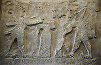 Rock Relief From Firaktin near the village of Gümüsören, Turkey.   king Hattusili III is also pouring a libation, a drink offering, to the Storm God god on the far left. 1275BC. A plaster cast from the Vorderasiatisches Museum, Pergamon Museum, Berlin