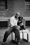 """RONALD AND ROSIE, 17-MONTH-OLD LABRADOR -- Ronald is incarcerated for murder in the second degree and has been in prison for 15 1/2 years. Ronald: """"I wanted to participate in the program because I committed such a  horrible crime against another human being. I've learned that life is so valuable and there's still an opportunity for me to make an atonement for my crime. It's taken away my selfishness. Rosie is a pleasure and she's very smart."""" ..The Puppies Behind Bars (PPB) Program works with prison inmates in New York, New Jersey, and Connecticut to train service dogs, including ones who help injured soldiers. The puppies arrive at 8 weeks-old and remain at the prisons, mostly working with one inmate, for 20 months. Fishkill Correctional Facility is a medium security prison in New York with 22 men in the puppy program. The emotional element of caring for the puppies breaks down the hard façade that most prisoners create for themselves to survive prison life.  Prisoners learn responsibility and pride in helping others. The program often gives them a new outlook on their crimes, their time in prison, and goals when they are released. .."""