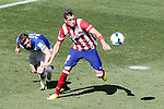 Atletico de Madrid's Jose Maria Gimenez (r) and UD Almeria's Rodri Rios during La Liga match.September 14,2013. (ALTERPHOTOS/Acero)
