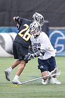 Washington, DC - February 23, 2019:Towson Tigers Koby Smith (26) knocks the stick out of Georgetown Hoyas Daniel Bucaro (4) hands during game between Towson and Georgetown at  Cooper Field in Washington, DC.   (Photo by Elliott Brown/Media Images International)
