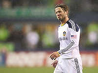L.A. Galaxy midfielder David Beckham reacts after getting a yellow card during play against the Seattle Sounders FC at Qwest Field in Seattle Tuesday March 15, 2011. The Galaxy won the game 1-0.