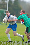 Castleisland Desmonds John Brennan holds off the attentions of Beale midfielder Maurice OConnor in their County League Division Two clash on Sunday..