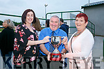 Enjoying the Friends of University Hospital Kerry 'Night at the Dog' in the Kingdom Greyhound Stadium on Friday were Emma McCarthy, Denis Guerin and Geraldine Nagel with the Kerry District League Perpetual Trophy