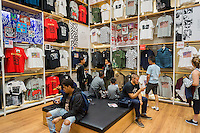 Shopping in the newly renovated Uniqlo store in Soho in New York on Saturday, September 3, 2016. (© Richard B. Levine)