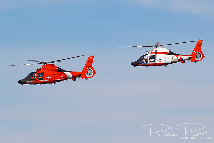 Pair of USCG MH-65 Dolphins from Air Station San Francisco in flight.