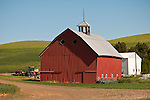 Red wooden barn with ventilator and red tractor, Washington's Palouse.