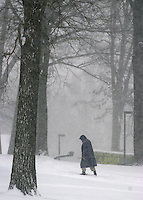 An unidentified woman walks through a snow storm, outside the Michener Museum, Thursday, December 5, 2002 in Doylestown, Pennsylvania. The Philadelphia region was expecting 4-6 inches of snow from it's first major winter storm in two years. (Photo by William Thomas Cain/photodx.com)