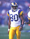 St. Louis Rams, Isaac Bruce (80)  during a game against the Tennessee Titans on October 31, 1999 at Adelphia Coliseum in Nashville, Tennessee.  The Titans beat the Rams 24-21.. Isaac Bruce played for 16 years with 2 different teams and was a 4-time Pro Bowler.