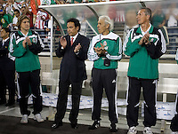 Mexico coaches, with head coach Hugo Sanchez in suit, clap for their national anthem. USA 2, Mexico 0, at the University of Phoenix Stadium in Glendale, AZ on February 7, 2007.