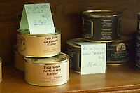 Conserve tins cans with different kinds of duck specialities Foie Gras de Canard Entier, whole pieces of duck liver and Pate of duck liver Ferme de Biorne duck and fowl farm Dordogne France Workshop on how to make foie gras duck liver pate and other conserves