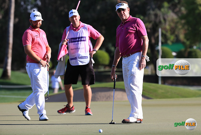 Watching the line is Miguel Angel Jimenez (ESP) and Andy Sullivan (ENG) during Round Two (Pink Friday) of the 2016 Omega Dubai Desert Classic, played on the Emirates Golf Club, Dubai, United Arab Emirates.  05/02/2016. Picture: Golffile | David Lloyd<br /> <br /> All photos usage must carry mandatory copyright credit (&copy; Golffile | David Lloyd)