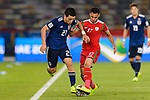 Doan Ritsu of Japan (L) fights for the ball with Ali Al Busaidi of Oman during the AFC Asian Cup UAE 2019 Group F match between Oman (OMA) and Japan (JPN) at Zayed Sports City Stadium on 13 January 2019 in Abu Dhabi, United Arab Emirates. Photo by Marcio Rodrigo Machado / Power Sport Images