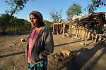 Griselda Arias at her home in Lote 75, an indigenous neighborhood of Embarcacion, Argentina. She is a leader of the Wichi, who in this area were largely traditional hunters and gatherers, but they have struggled for decades to recover land that has been systematically stolen from them by cattleraisers and large agricultural plantations.