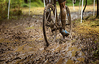 NWA Democrat-Gazette/BEN GOFF @NWABENGOFF<br /> A competitor in the UCI Junior Men race pedals through mud Sunday, Oct. 6, 2019, during the the Fayettecross cyclocross races at Centennial Park at Millsap Mountain in Fayetteville.
