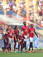 Manchester United's Ashley Young, Paul Pogba and Alexis Sanchez walk out prior to the match with their mascots<br /> <br /> Photographer Rob Newell/CameraSport<br /> <br /> Emirates FA Cup Final - Chelsea v Manchester United - Saturday 19th May 2018 - Wembley Stadium - London<br />  <br /> World Copyright &copy; 2018 CameraSport. All rights reserved. 43 Linden Ave. Countesthorpe. Leicester. England. LE8 5PG - Tel: +44 (0) 116 277 4147 - admin@camerasport.com - www.camerasport.com