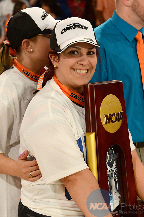 12 APR 2014:  Nieshka Cardona from Sam Houston State University holds on to the championship trophy following the Division I Women's Bowling Championship held at Game of Wickliffe in Wickliffe, OH.  Sam Houston State University defeated Nebraska 4-2 for the national title.  Eric Mull/NCAA Photos