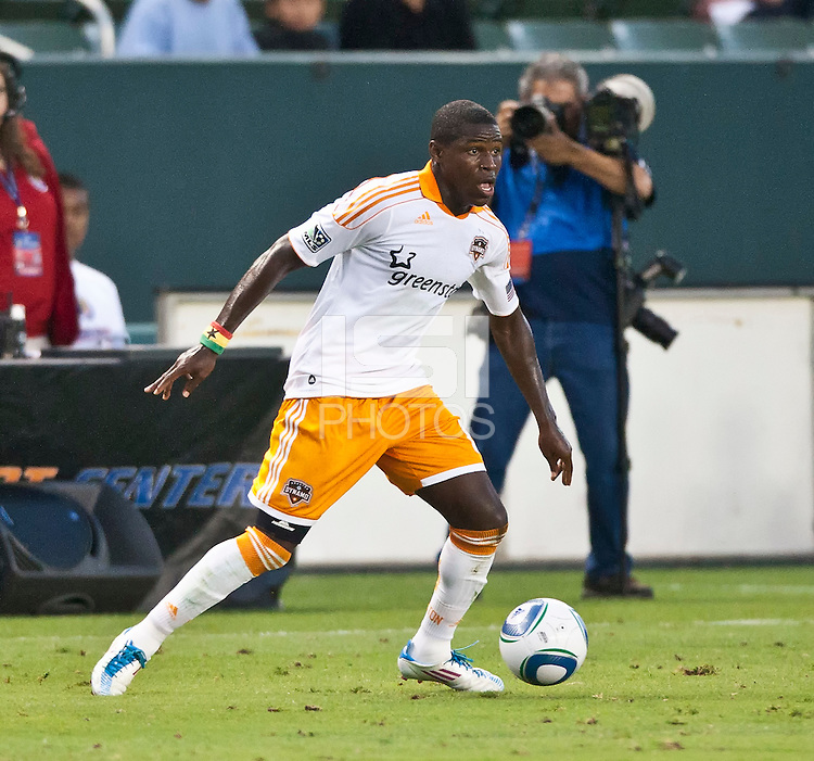 CARSON, CA – July 23, 2011: Houston Dynamo defender Kofi Sarkodie (8) during the match between Chivas USA and Houston Dynamo at the Home Depot Center in Carson, California. Final score Chivas USA 3, Houston Dynamo 0.