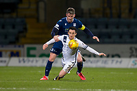 3rd March 2020; Dens Park, Dundee, Scotland; Scottish Championship Football, Dundee FC versus Alloa Athletic; Josh Meekings of Dundee challenges for the ball with Kevin Cawley of Alloa Athletic