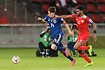 Ito Junya of Japan (L) is challenged by Ahmed Al Mahaijri of Oman (R) during the AFC Asian Cup UAE 2019 Group F match between Oman (OMA) and Japan (JPN) at Zayed Sports City Stadium on 13 January 2019 in Abu Dhabi, United Arab Emirates. Photo by Marcio Rodrigo Machado / Power Sport Images