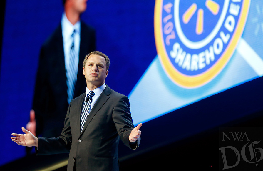 NWA Media/JASON IVESTER --06/06/2014--<br /> Doug McMillon, Wal-Mart chief executive officer, speaks on stage on Friday, June 6, 2014, during the annual Shareholders Meeting inside Bud Walton Arena in Fayetteville.