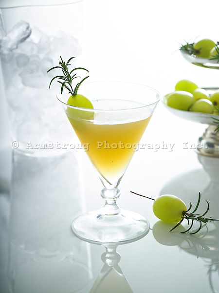 Grape juice and rosemary cocktail in a cocktail glass