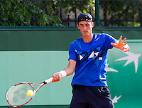 Bernard Tomic..Tennis - Grand Slam - French Open- Roland Garros - Paris - Mon May 28th 2012...© AMN Images, 30, Cleveland Street, London, W1T 4JD.Tel - +44 20 7907 6387.mfrey@advantagemedianet.com.www.amnimages.photoshelter.com.www.advantagemedianet.com.www.tennishead.net